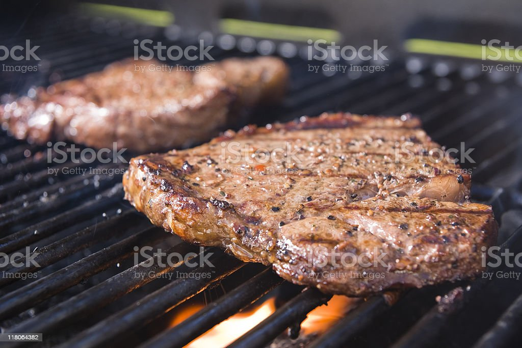 Cooking Steaks royalty-free stock photo