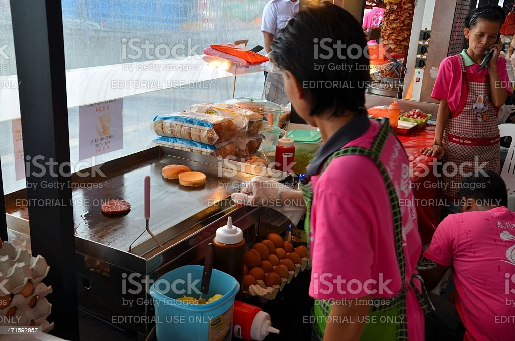 Cooking street side 'Ramly' burgers in Singapore Asia stock photo