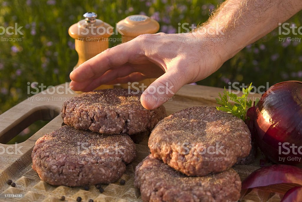 Cooking Summer Hamburgers; Man Preparing Beef Burgers for Barbeque Grill royalty-free stock photo