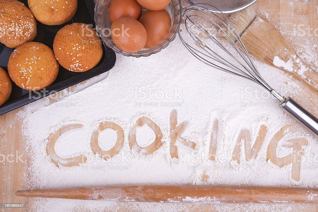 cooking text with kitchen utensil and cake on wood stock photo