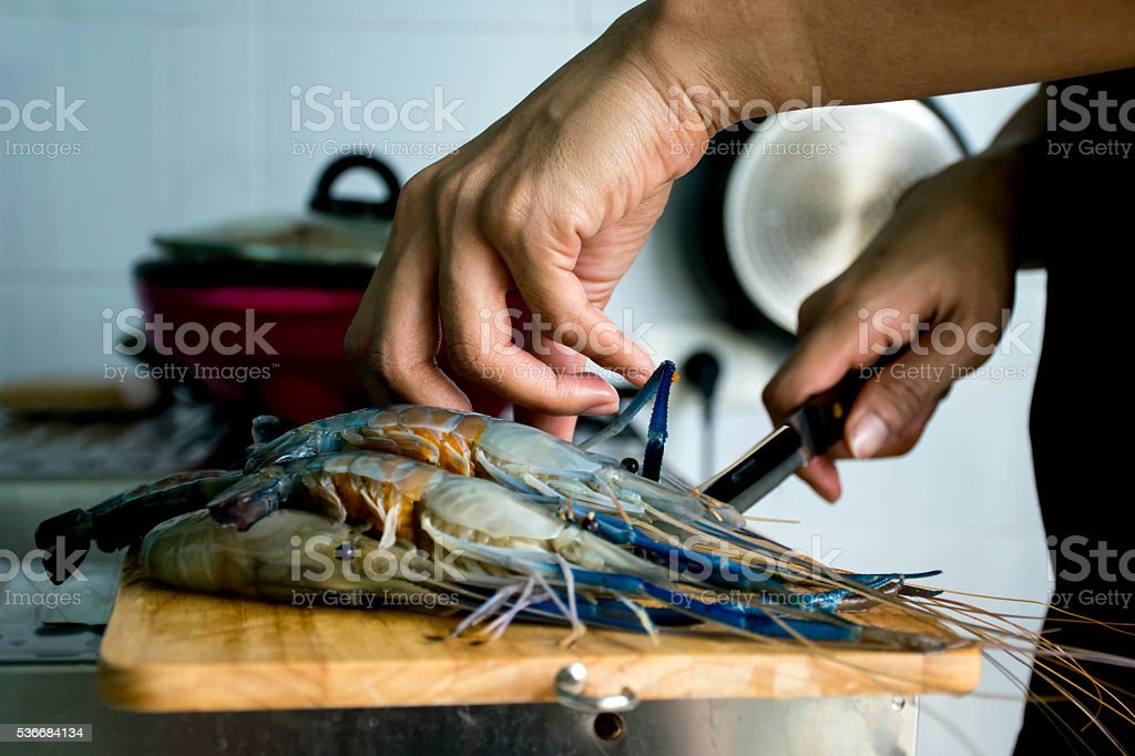 cooking thai seafood in the kitchen stock photo