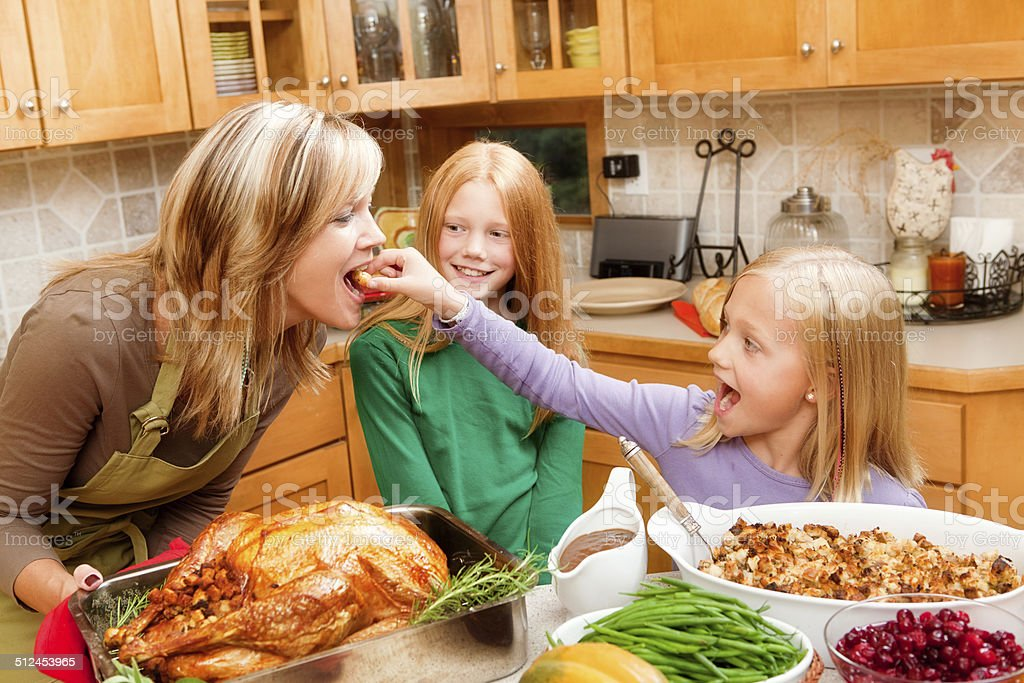 Cooking Thanksgiving and Christmas Family Dinner with Kids in Kitchen stock photo