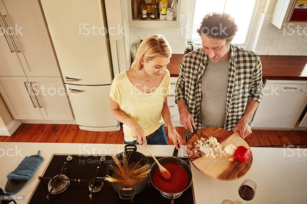 Cooking together is quality time together stock photo