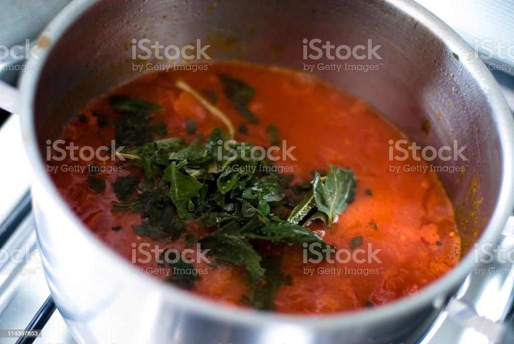 Cooking tomato paste royalty-free stock photo
