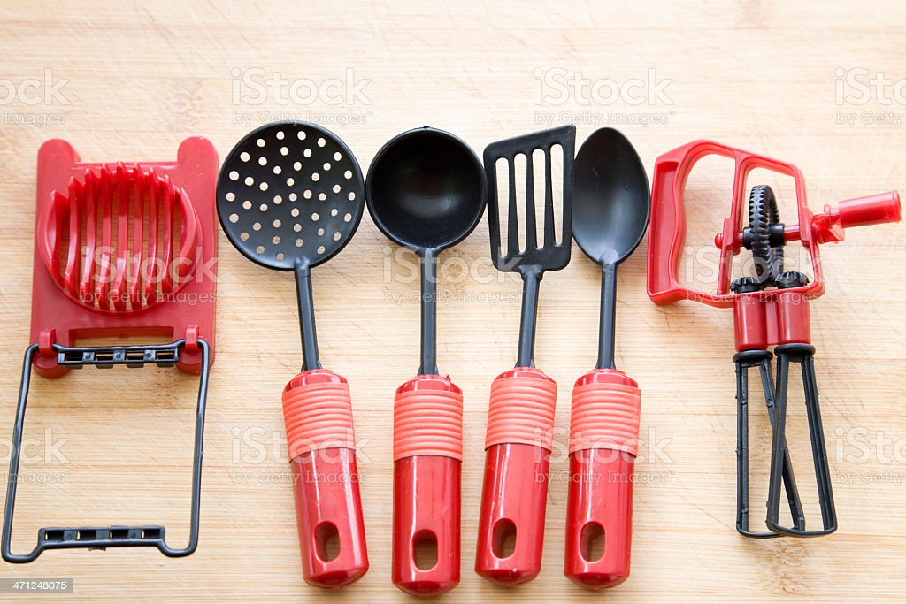 cooking tools on wooden chopping board royalty-free stock photo
