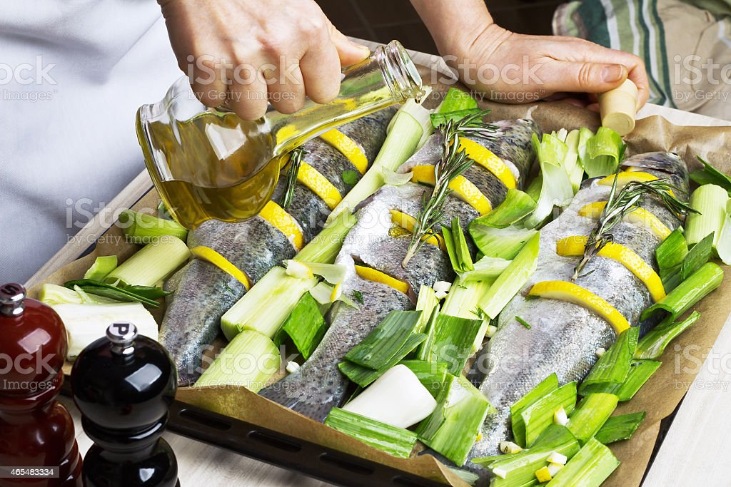 Cooking trout fish with lemon. stock photo