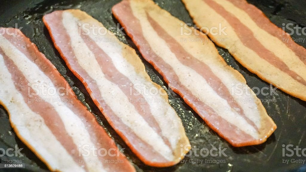 Cooking Turkey Bacon stock photo