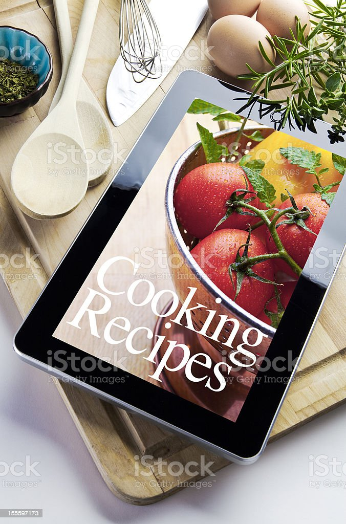 Cooking using Digital Tablet royalty-free stock photo