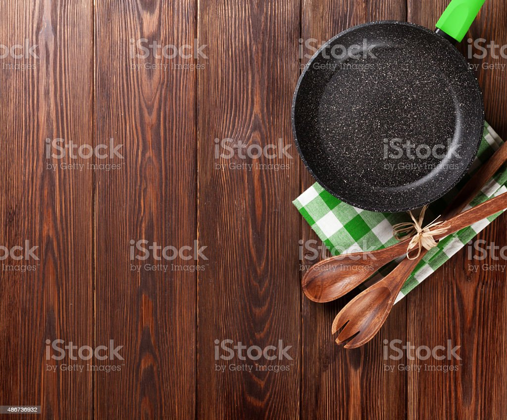 Cooking utensil on wooden table stock photo