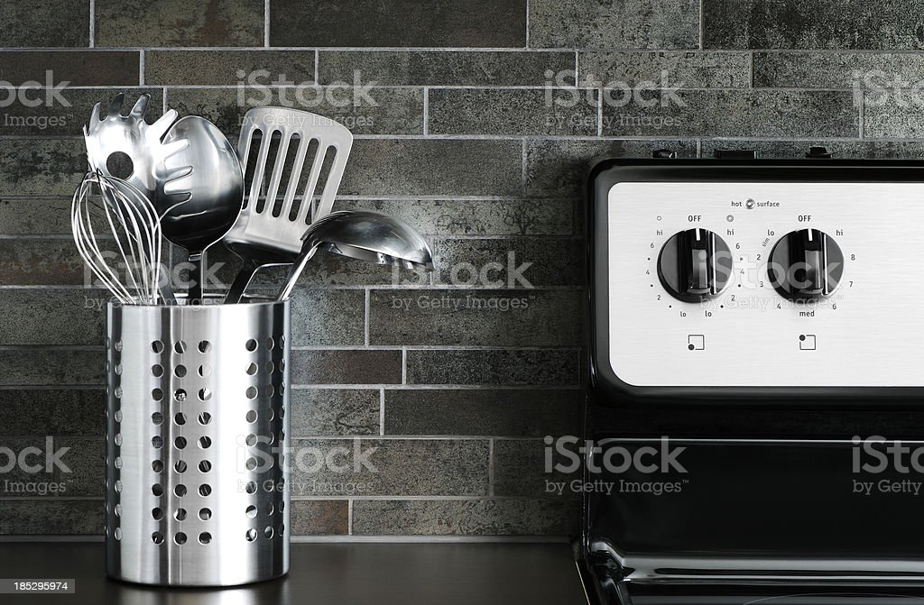 Cooking utensils and stove stock photo