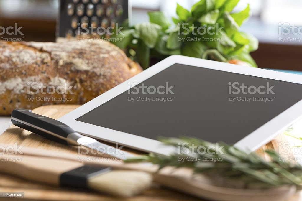 Cooking with a digital tablet. stock photo