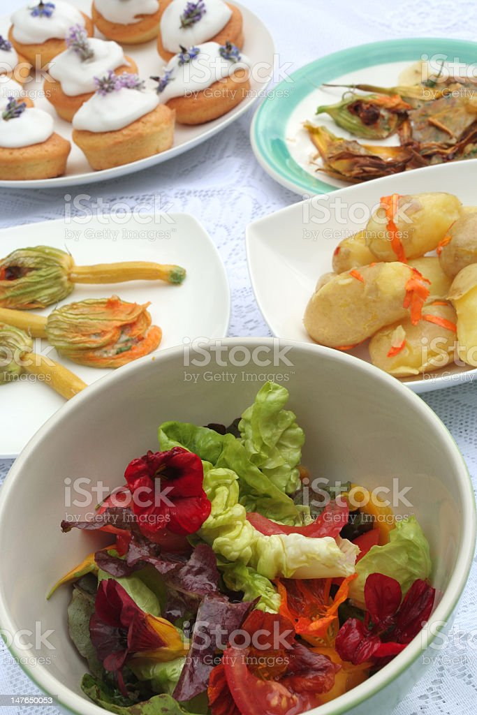 cooking with edible flowers stock photo