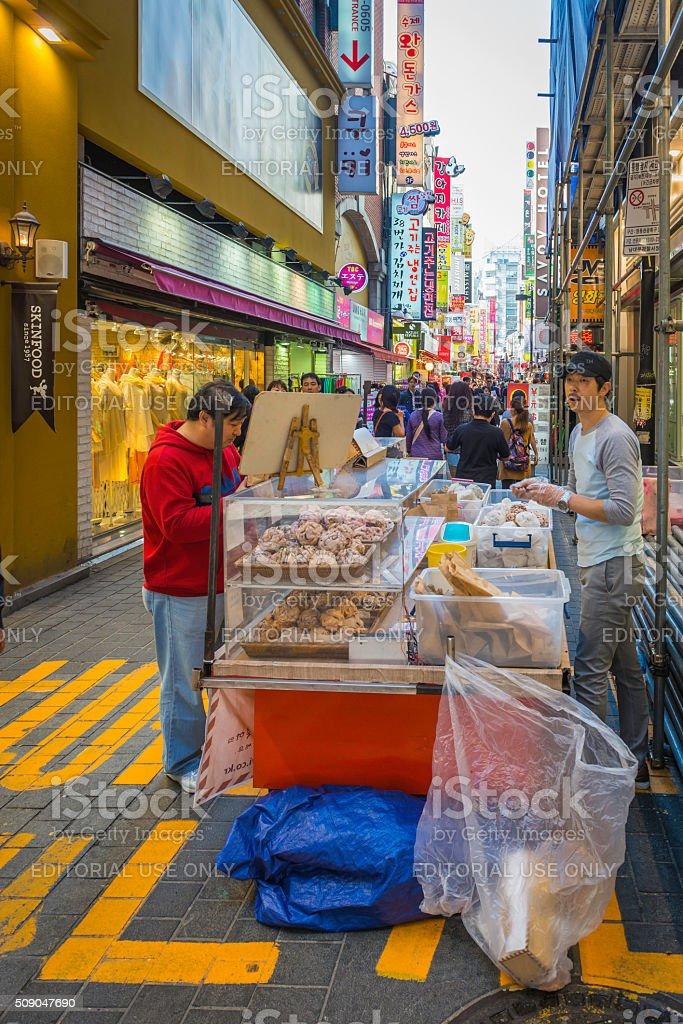 Cooks and customers food stall crowded shopping street Seoul Korea stock photo