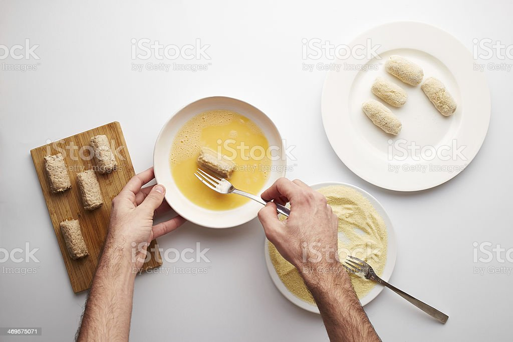 Cook's hands preparing croquettes royalty-free stock photo