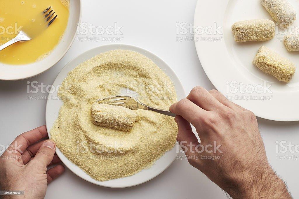 Cook's hands preparing croquettes stock photo