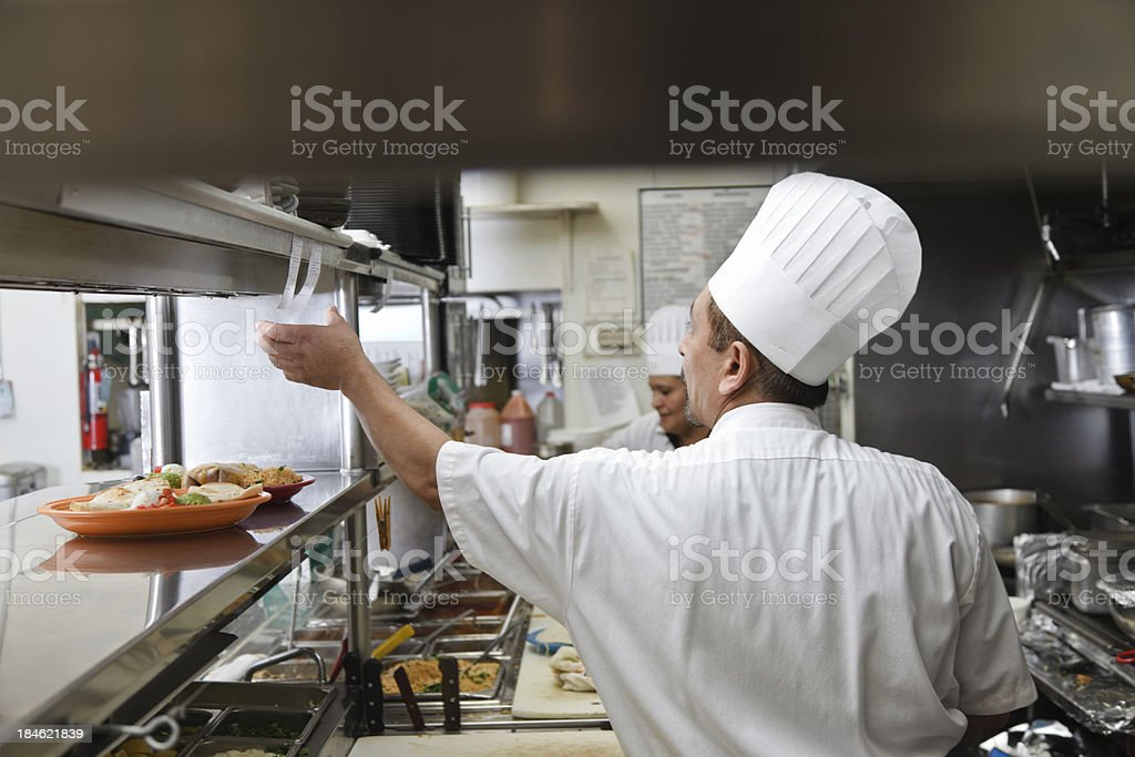 Cooks in Kitchen of Mexican Restaurant royalty-free stock photo