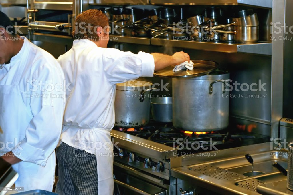 Cooks in Restaurant Kitchen royalty-free stock photo