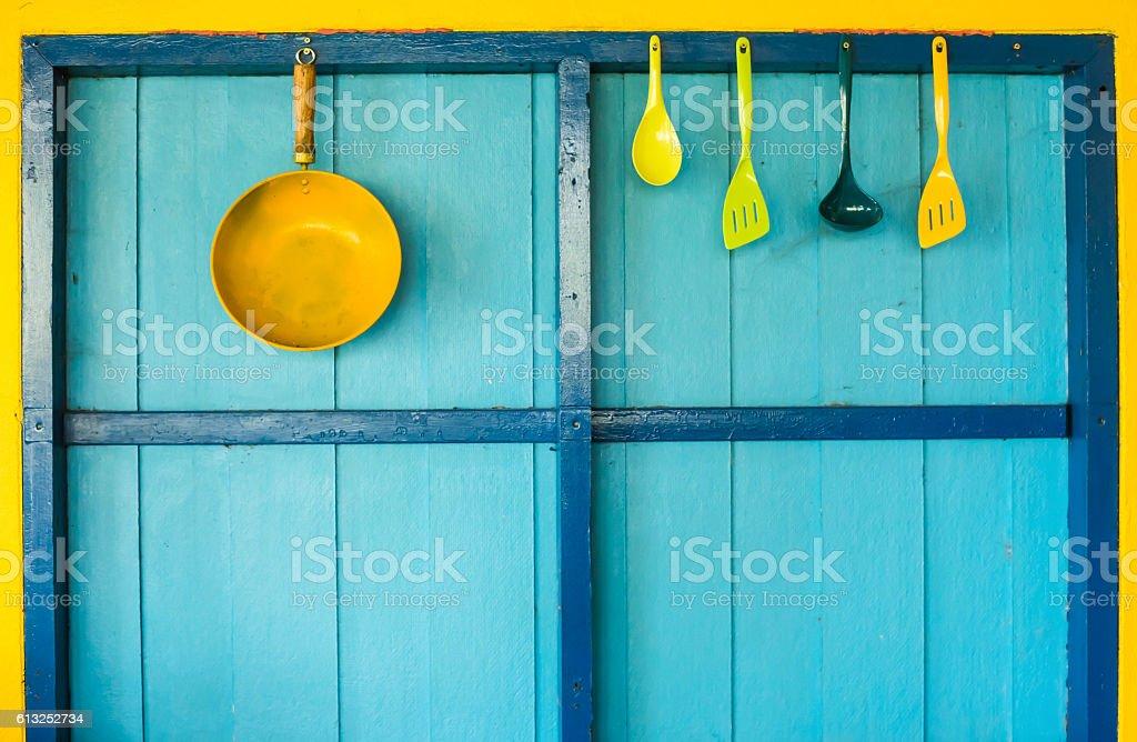cookware hang on colorful wall stock photo