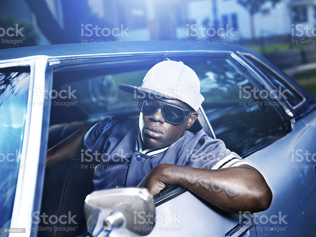 cool african man in old car stock photo