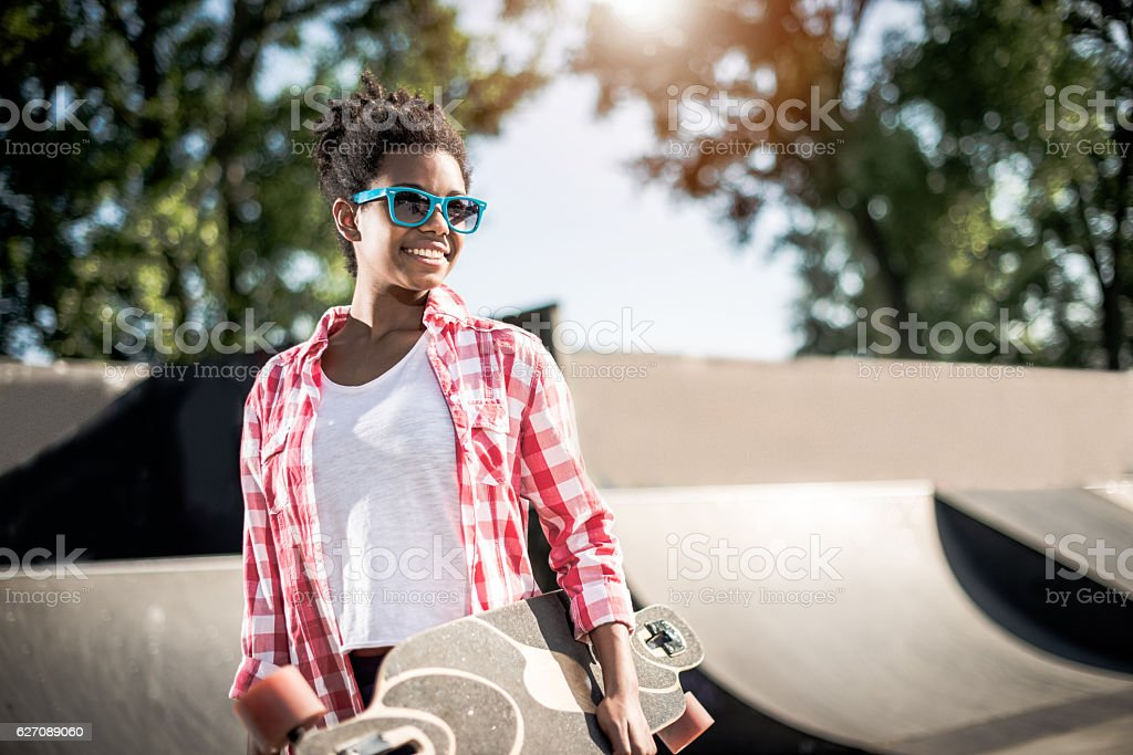 Cool African-American teenage girl in skate park stock photo