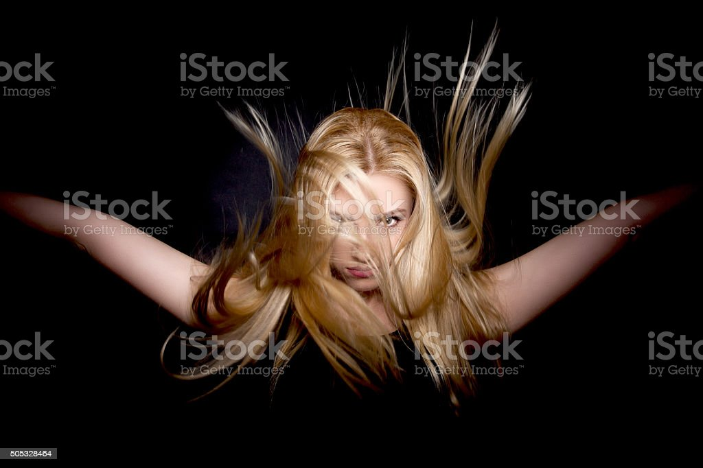 Cool and Glamorous Blonde Woman with  Beautiful Flying Hair stock photo