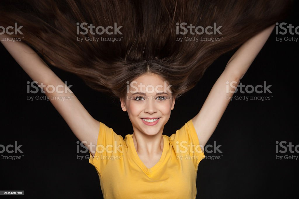Cool and Glamorous Young Woman with  Beautiful Flying Hair stock photo
