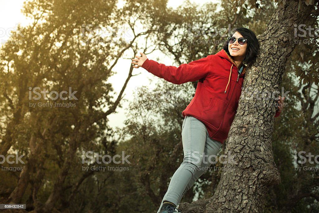 Cool Asian girl enjoying freedom in nature. stock photo