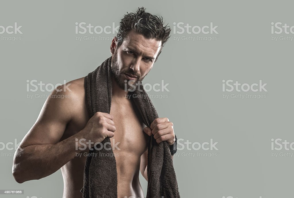 Cool athletic man posing with towel stock photo