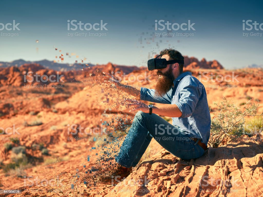 cool bearded guy wearing vr goggles stock photo