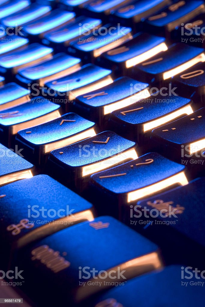 Cool, blue and orange keyboard stock photo