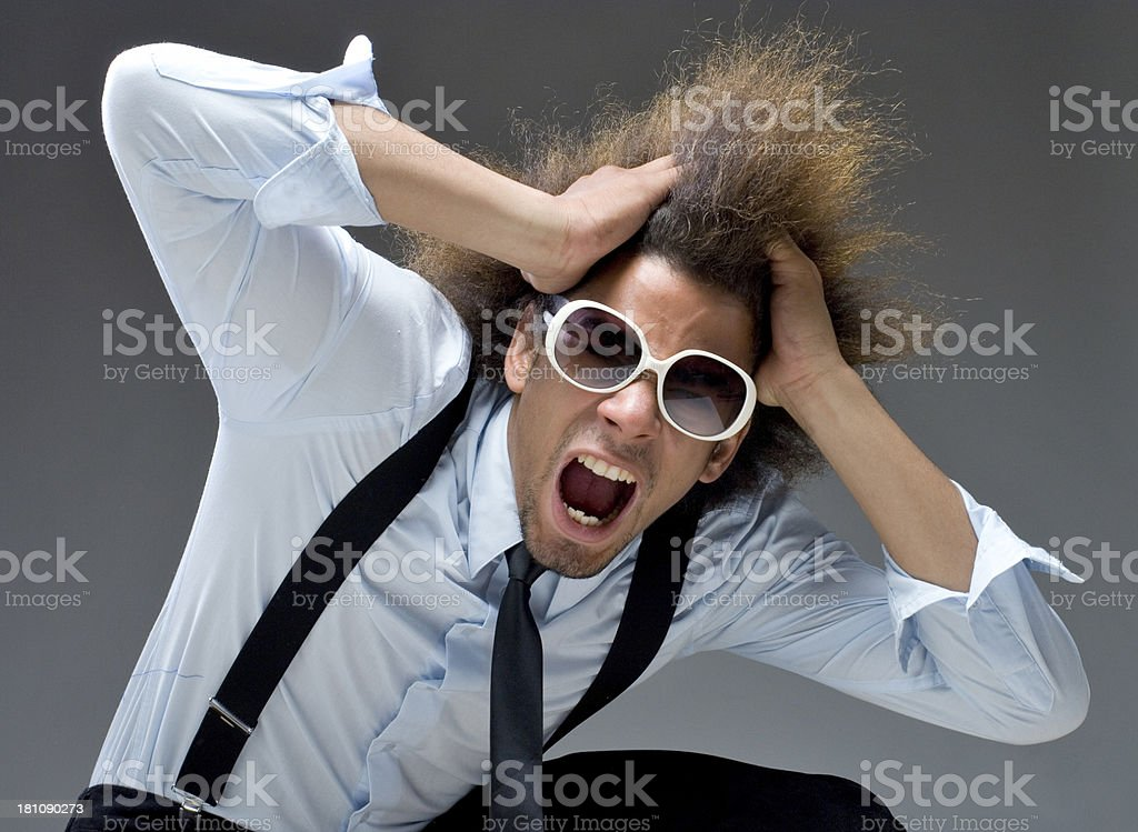 cool businessman tearing hair out royalty-free stock photo
