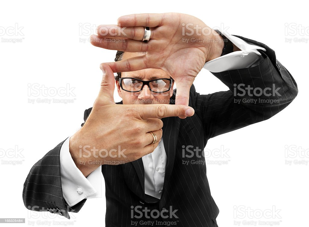 Cool businessman with framing hands royalty-free stock photo