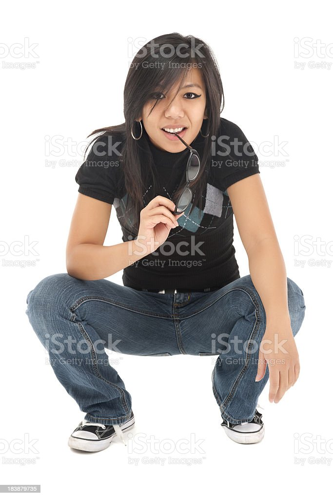Cool Casual Young Asian Woman Crouching royalty-free stock photo