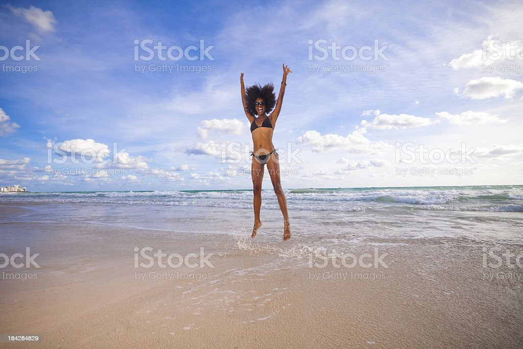 Cool  female jumping at beach royalty-free stock photo