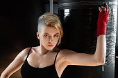 Cool fit woman and punching bag.