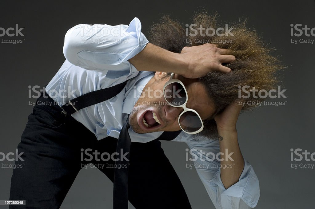 cool funky businessman tearing hair out royalty-free stock photo