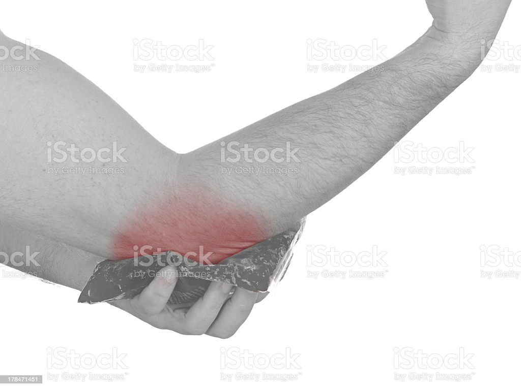 Cool gel pack on a swollen hurting elbow. royalty-free stock photo