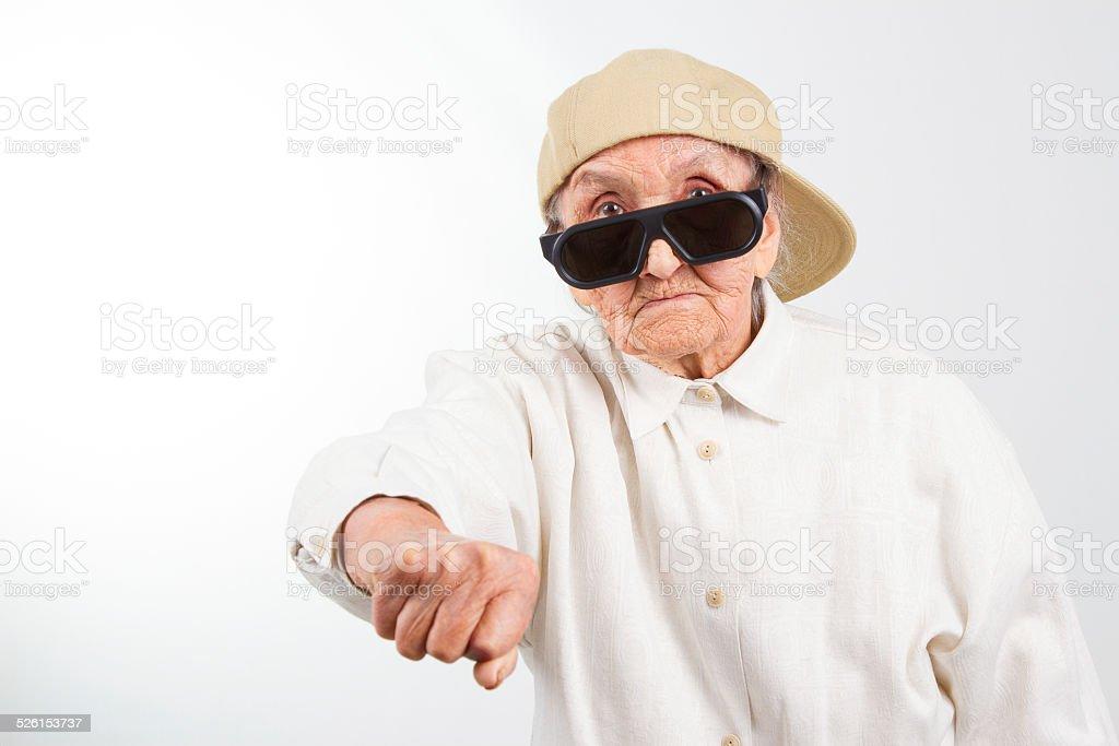 cool grandma kicks with her fist stock photo