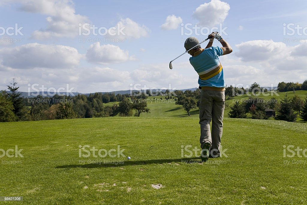 cool guy playing golf. royalty-free stock photo