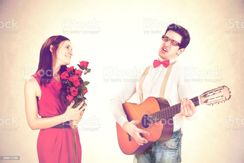 cool guy winning His Woman with a sweet serenade stock photo