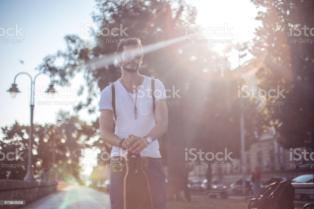 Cool guy with a longboard stock photo