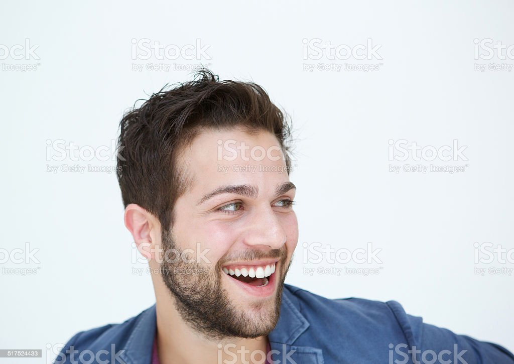 Cool guy with beard laughing on white background stock photo