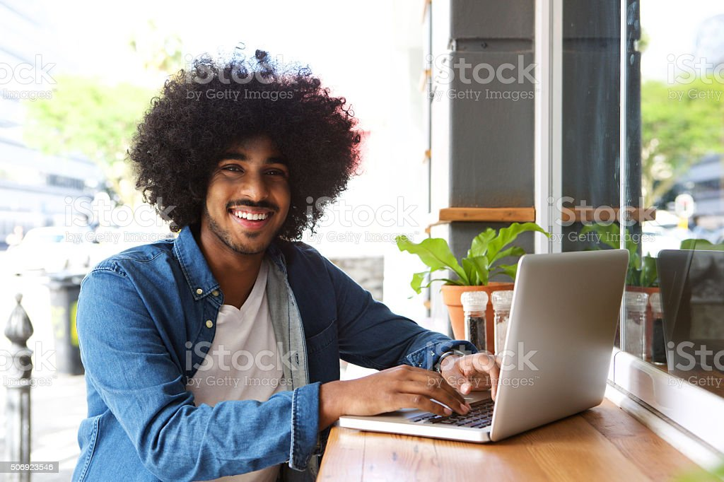 Cool guy working with laptop stock photo