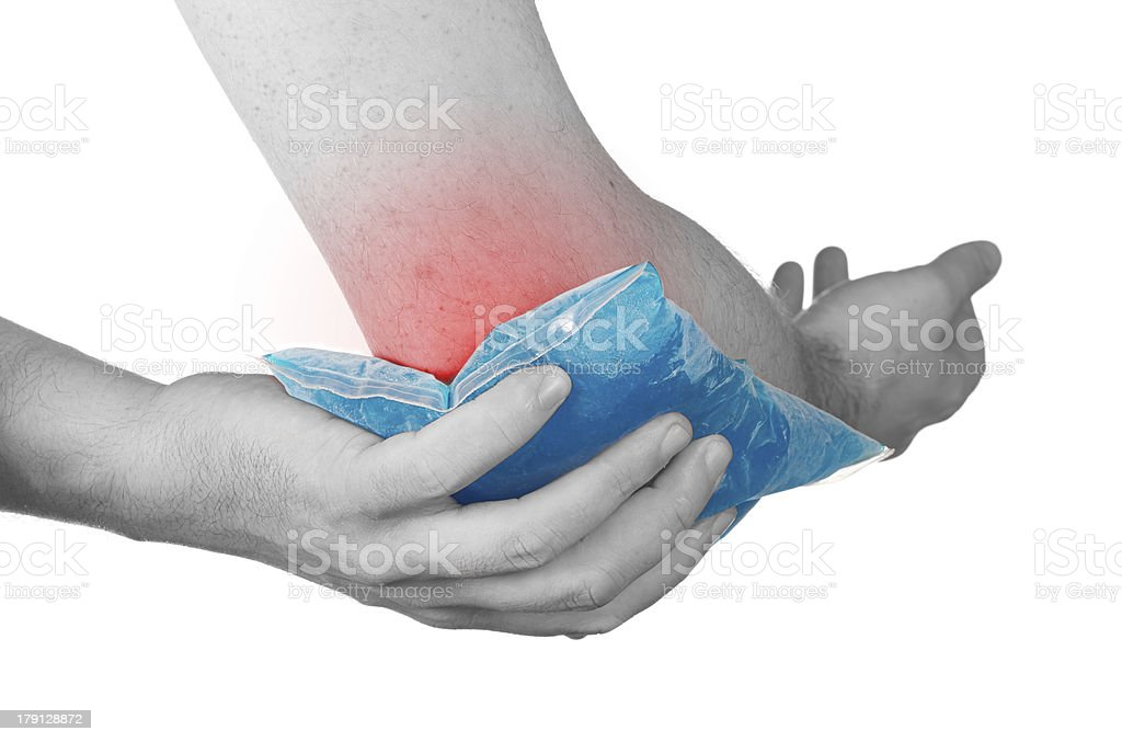 Cool ice on a swollen hurting elbow. royalty-free stock photo