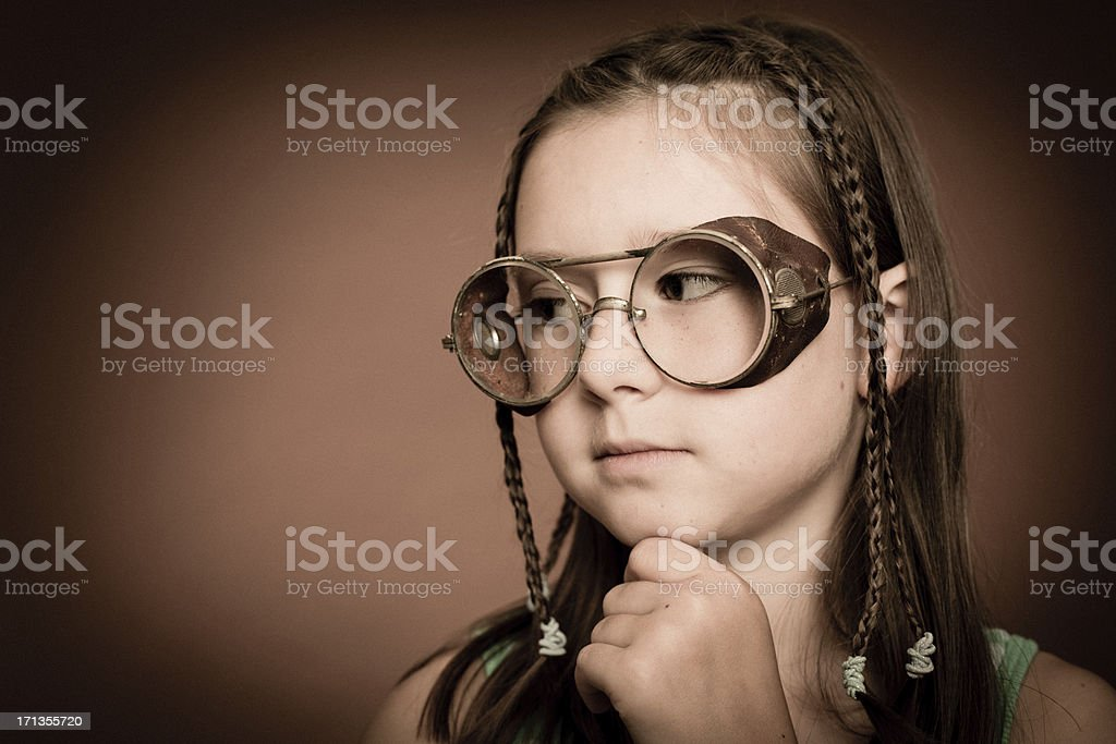 Cool Little Girl Wearing Steampunk Glasses, With Copy Space royalty-free stock photo