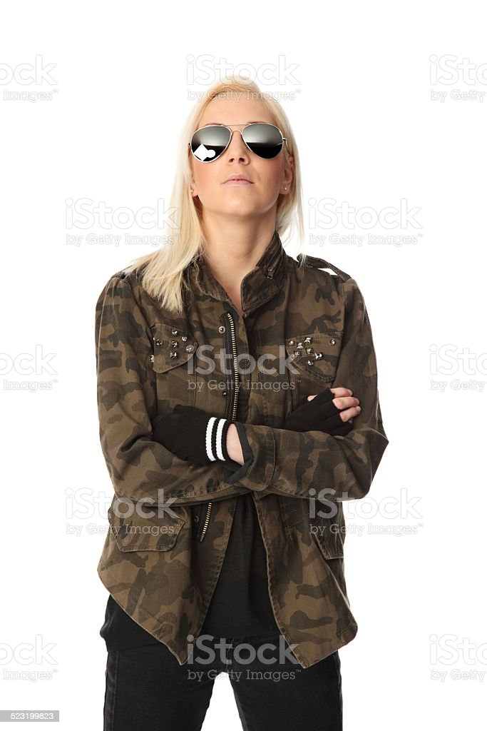 Cool looking rocker chic in jacket stock photo