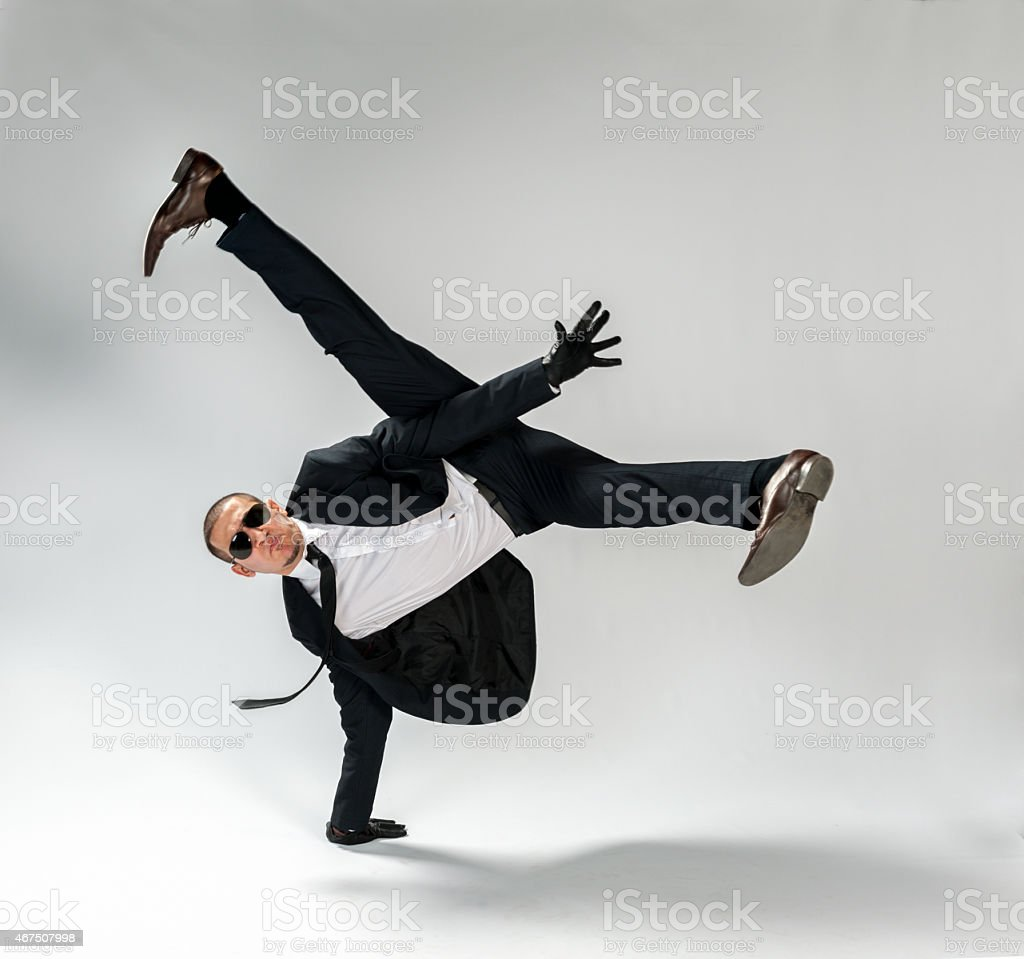 cool looking,breakdancing businessman, free run stock photo