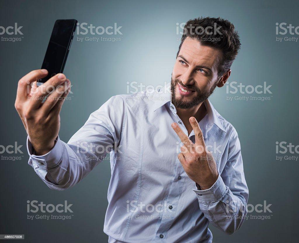 Cool man taking a selfie stock photo