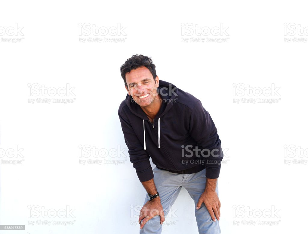 Cool middle aged guy smiling against white background stock photo