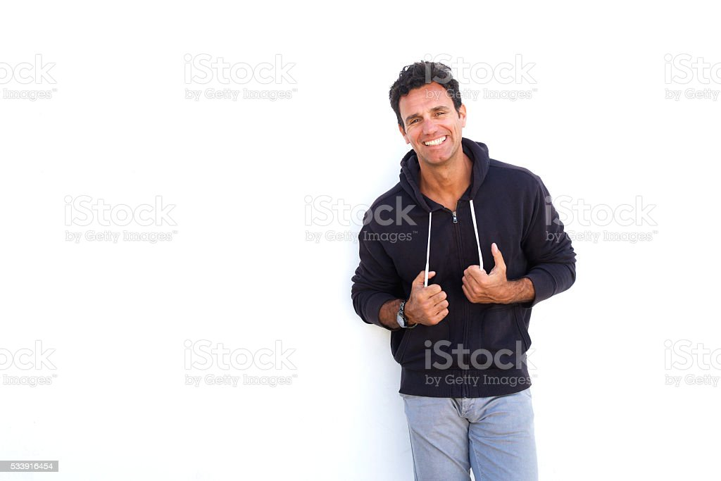 Cool middle aged man smiling against white background stock photo